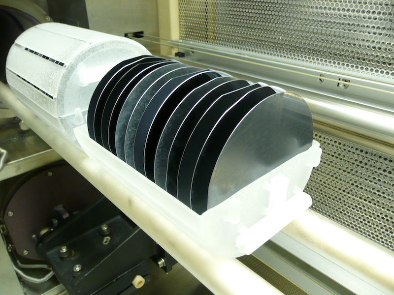 A boat of silicon wafers ready for processing in a semiconductor lab.